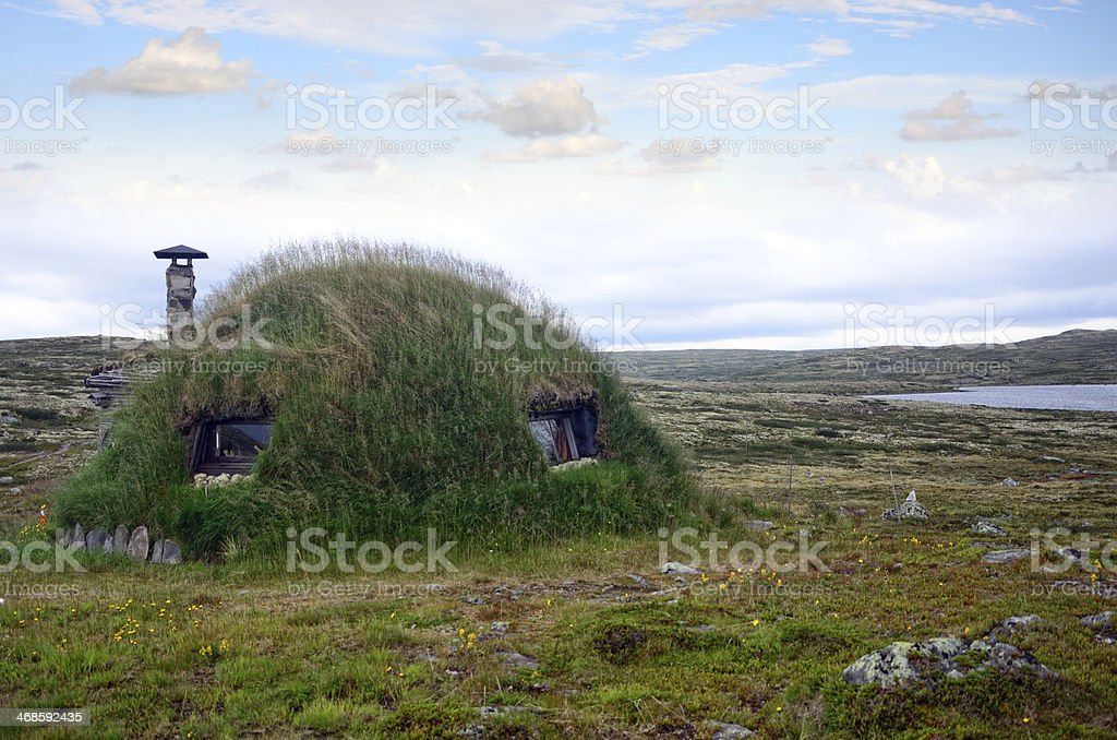 Grass Roofed Hut stock photo