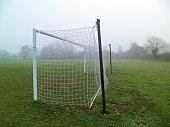 Grass roots amateur football goal with net