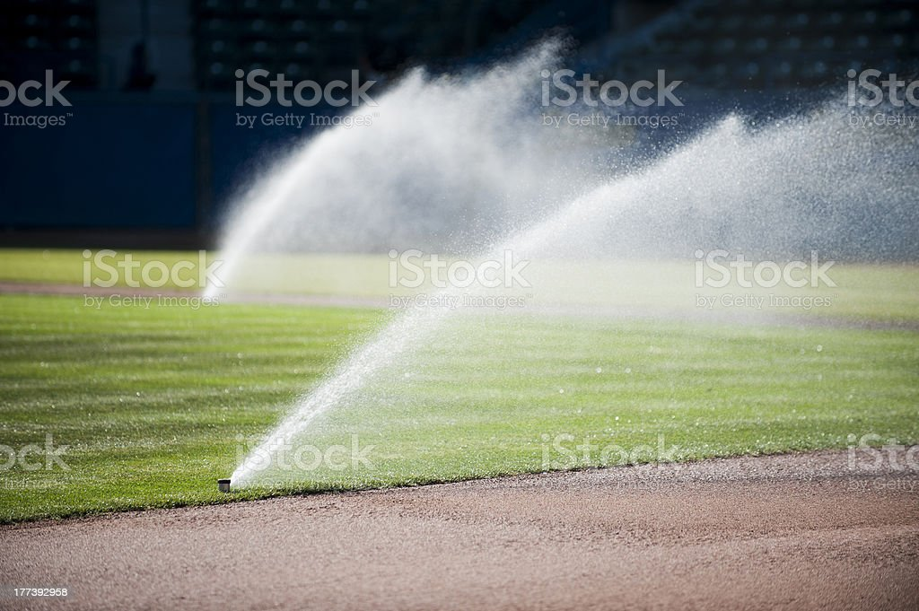 Grass Sprinklers stock photo