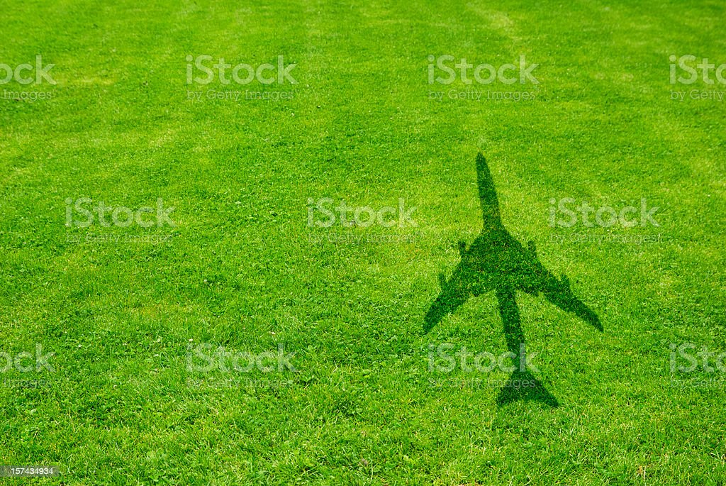 Grass with airplane shadow stock photo