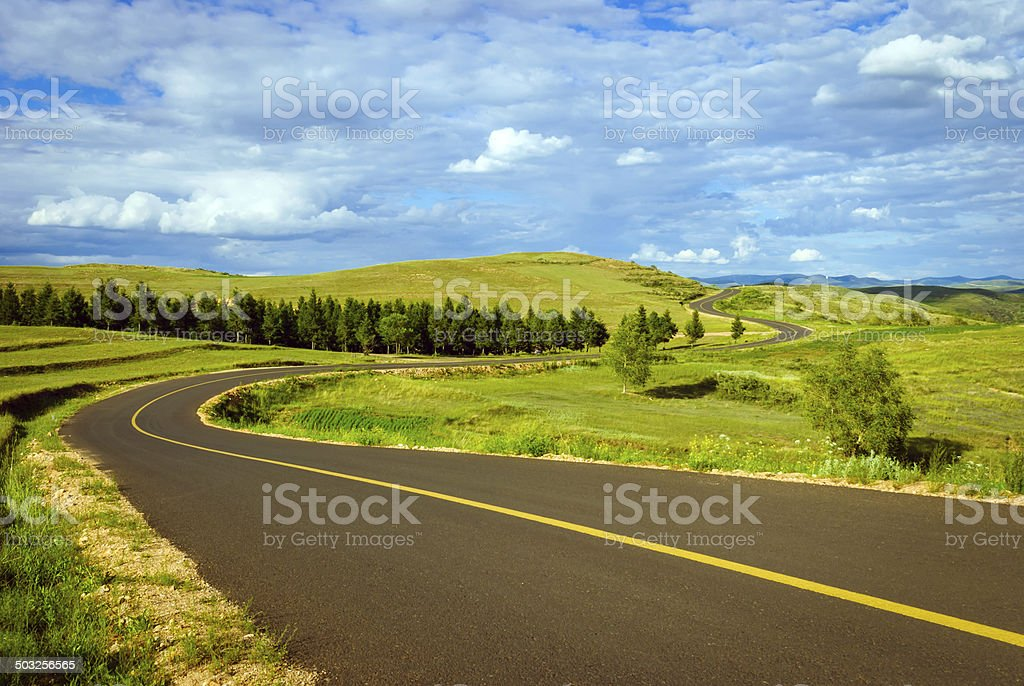 grassland and Country road stock photo