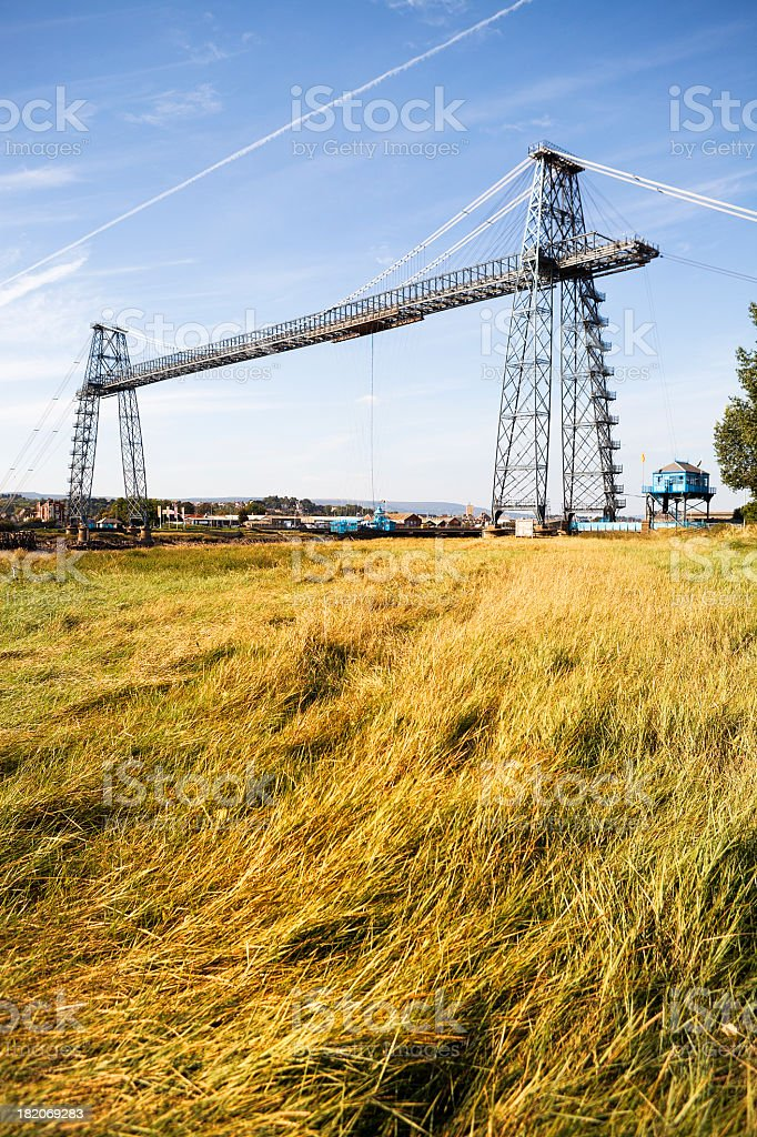 Grassy field at foreground of the Newport Transporter Bridge stock photo