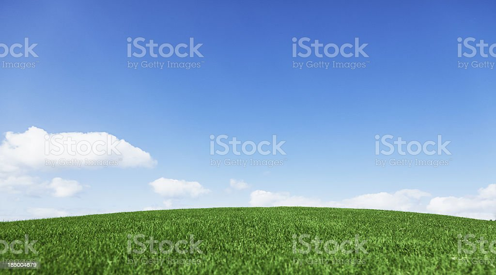 Grassy hill beautiful blue sky horizon royalty-free stock photo
