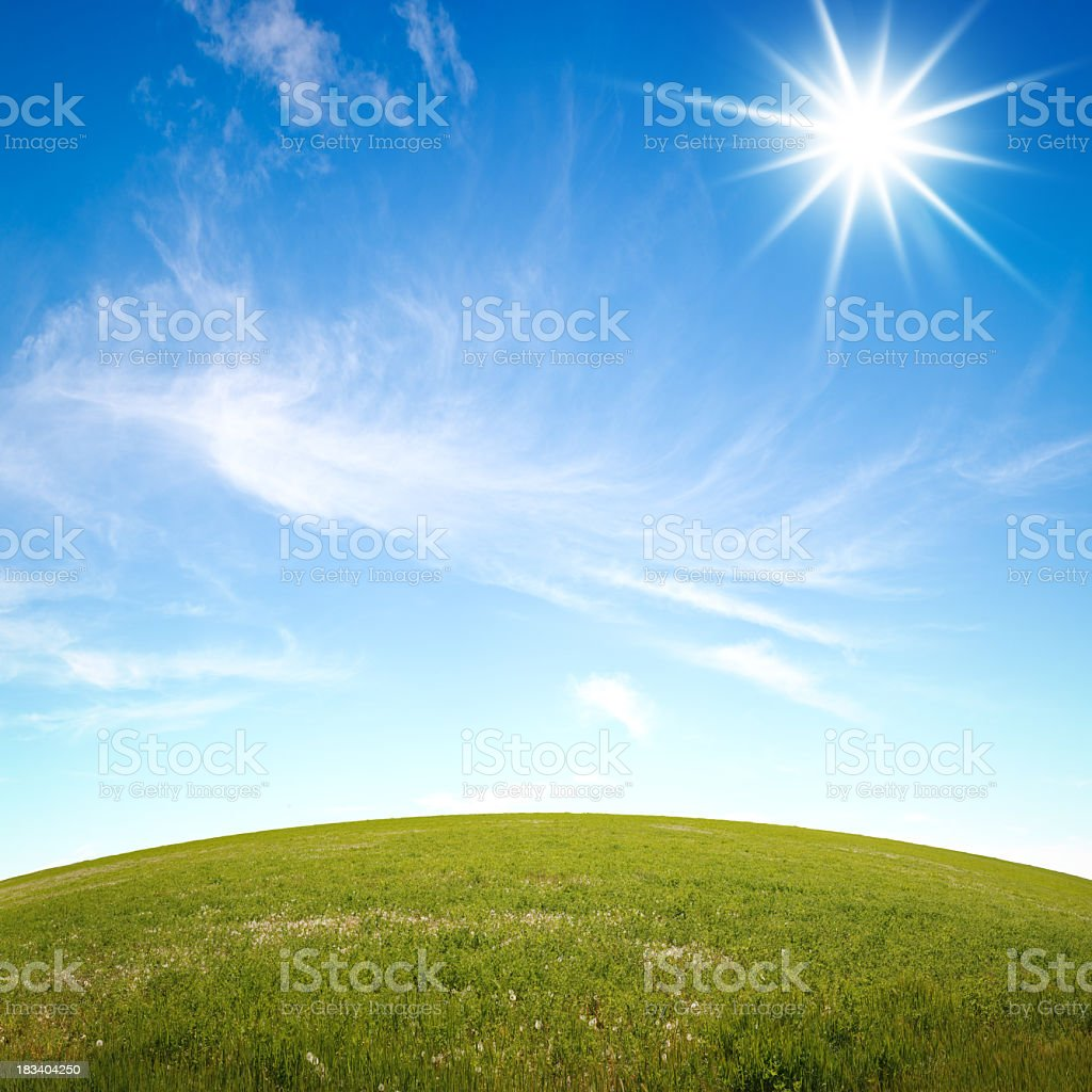 Grassy Hill & Sunny Sky stock photo