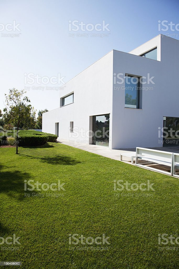 Grassy lawn of modern house royalty-free stock photo