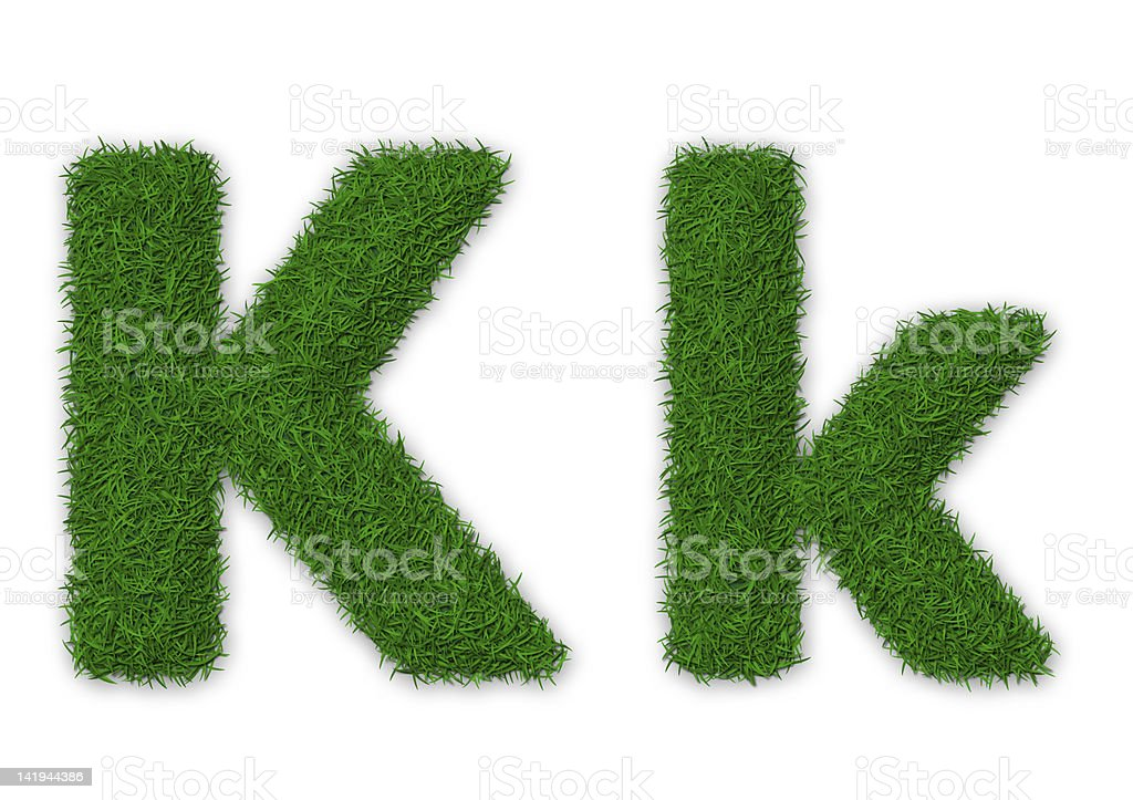 Grassy letter K royalty-free stock photo