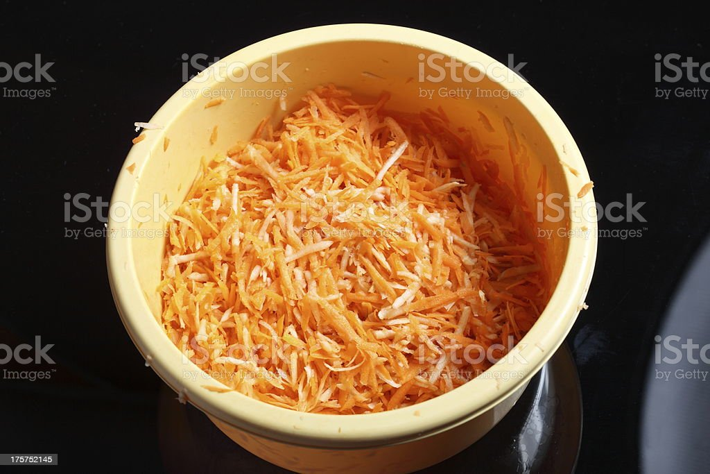 grated carrots in a bowl vegetables salad royalty-free stock photo
