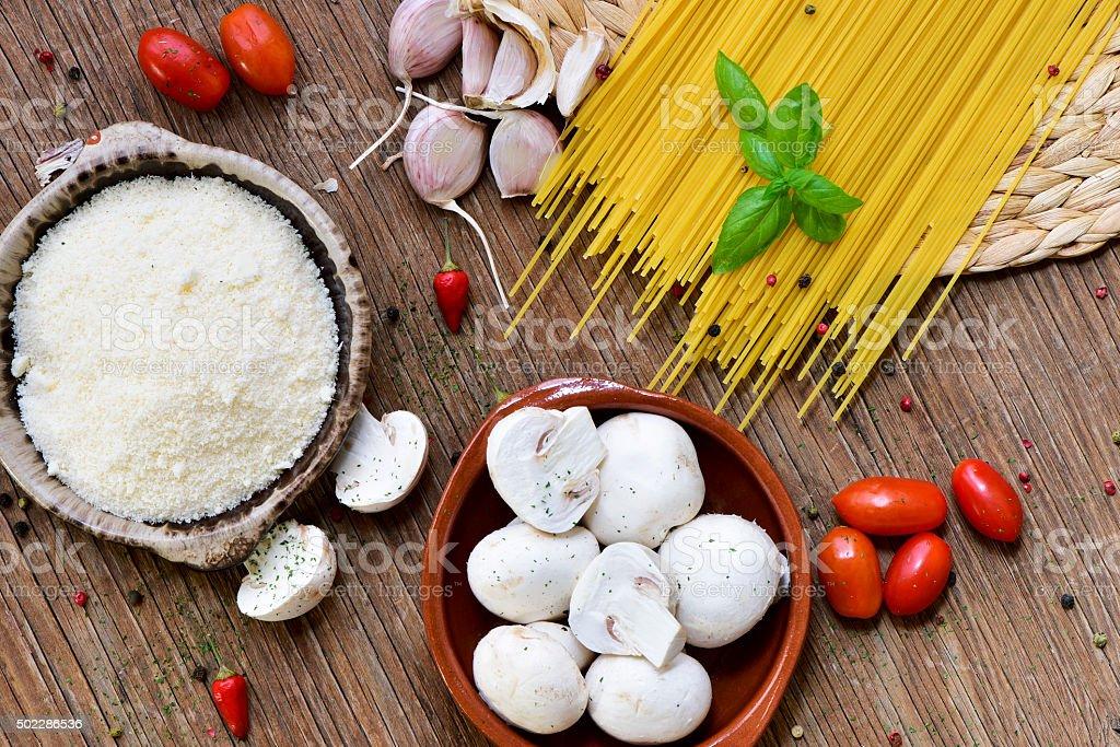 grated cheese, garlics, mushrooms, cherry tomatoes and spaghetti stock photo
