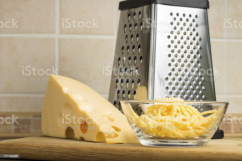 Grated Cheese with Grater royalty-free stock photo