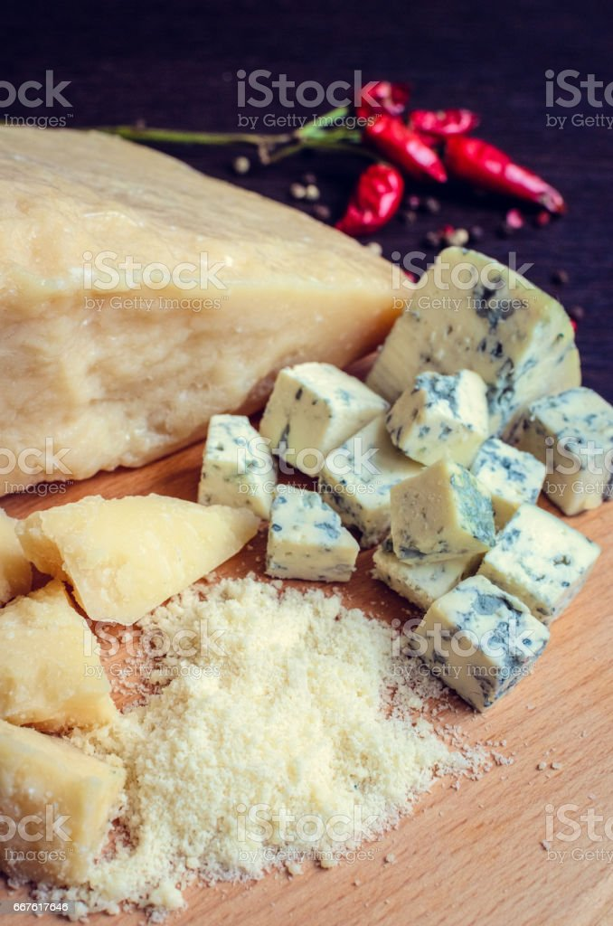 Grated Parmesan and sliced Blue cheese stock photo