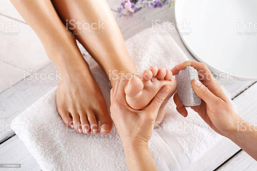 Grater feet, pedicure treatment stock photo