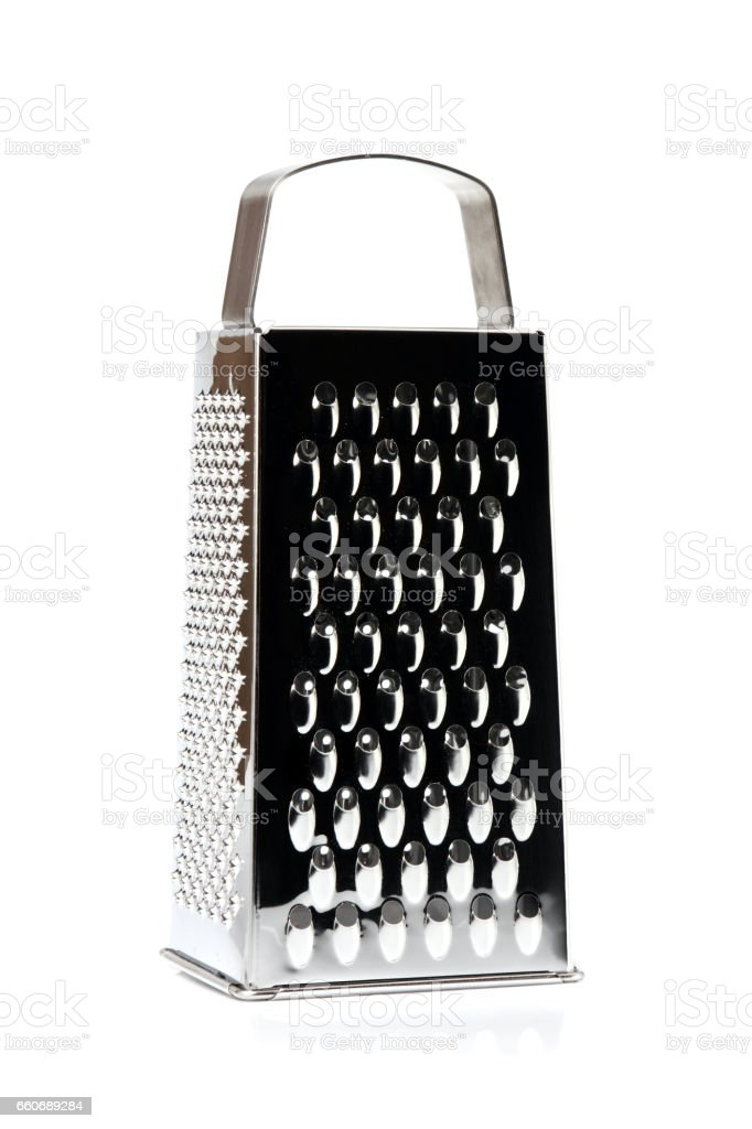 Grater stainless steel closeup isolated. stock photo