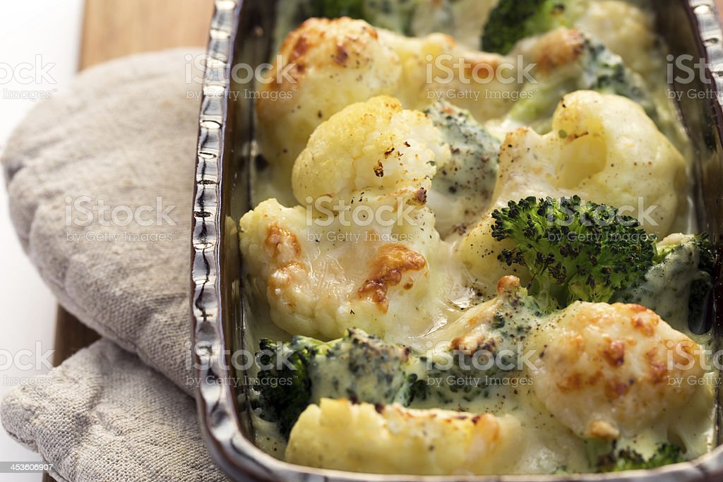 Gratin of cauliflower, broccoli and cheese royalty-free stock photo