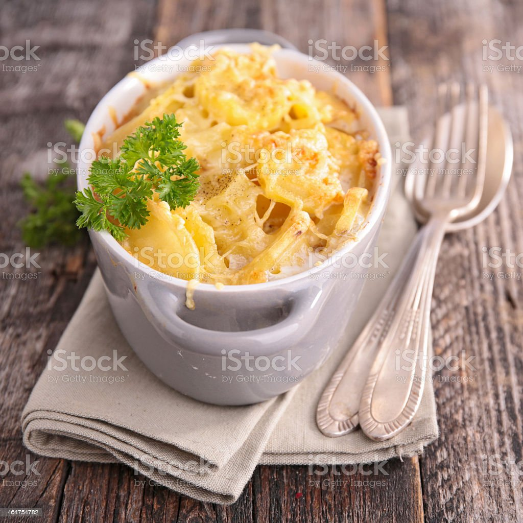 Gratin on grey napkin with fork and spoon stock photo