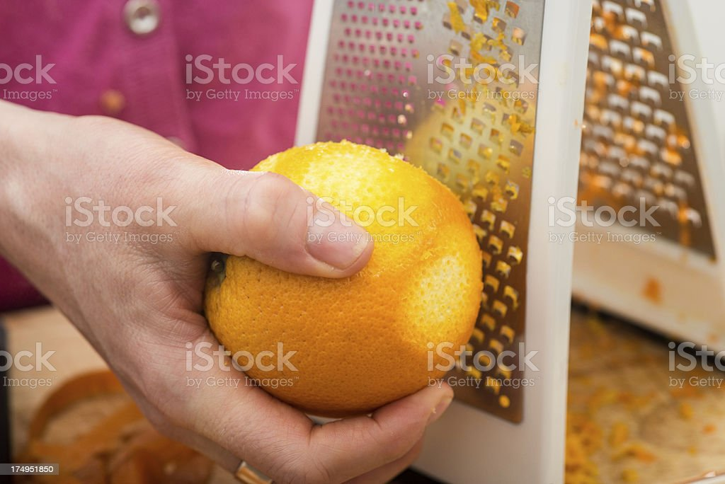 Grating an Orange royalty-free stock photo