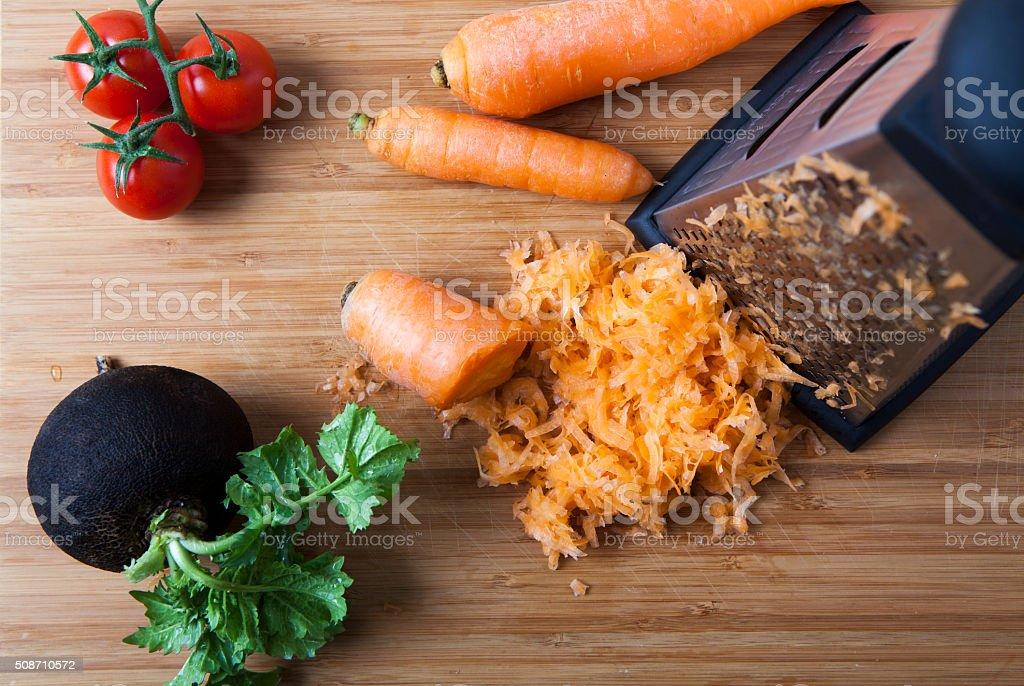 grating carrot stock photo