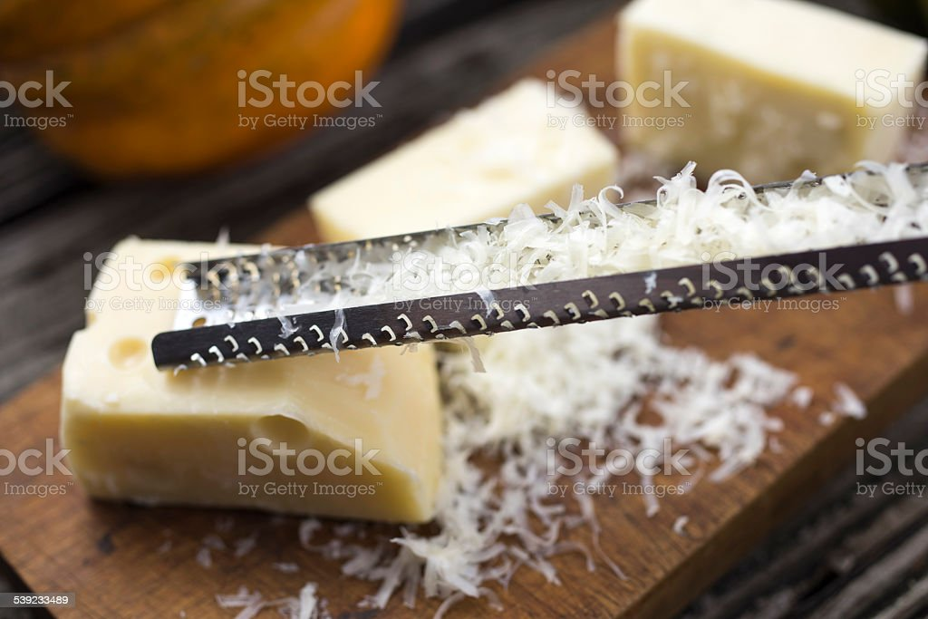 Grating Cheese. stock photo