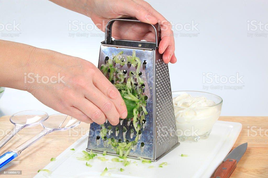 Grating cucumber stock photo