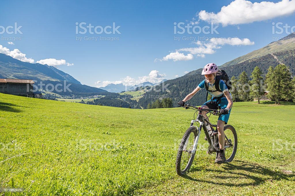 Graubünden grass biking, Switzerland stock photo