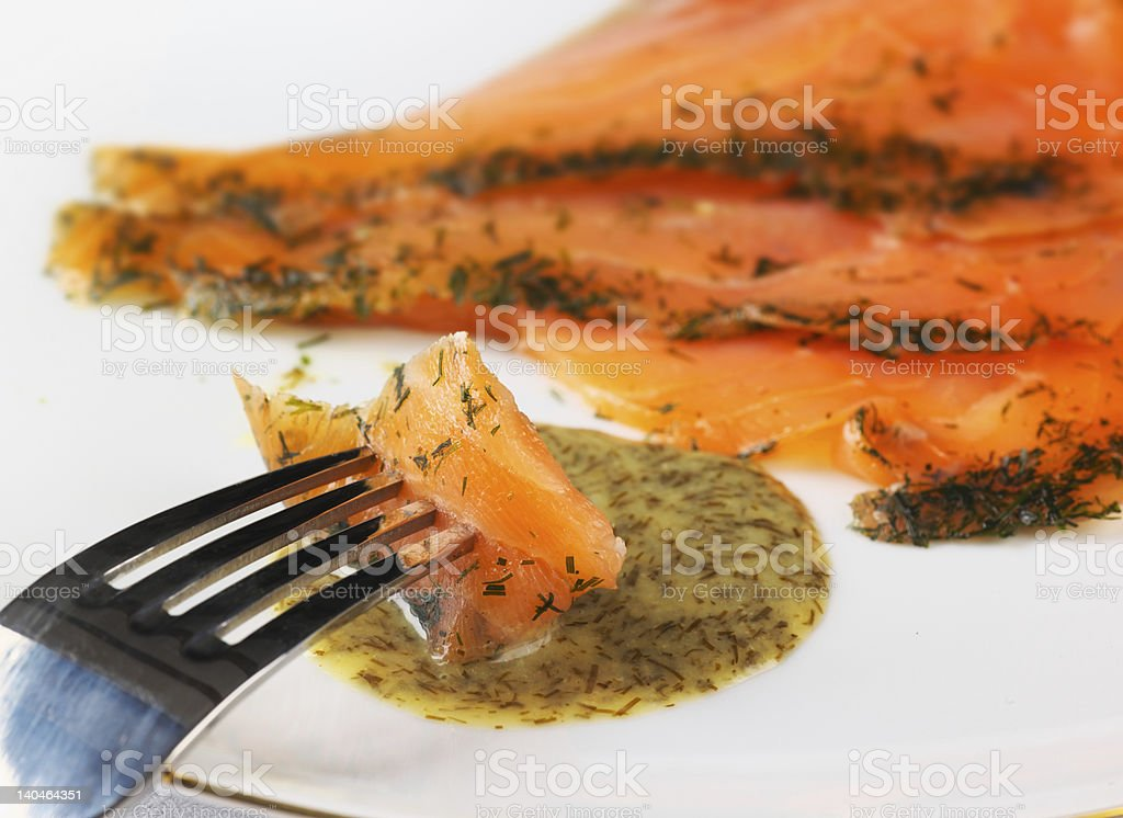 Gravadlax dipped in dill sauce royalty-free stock photo
