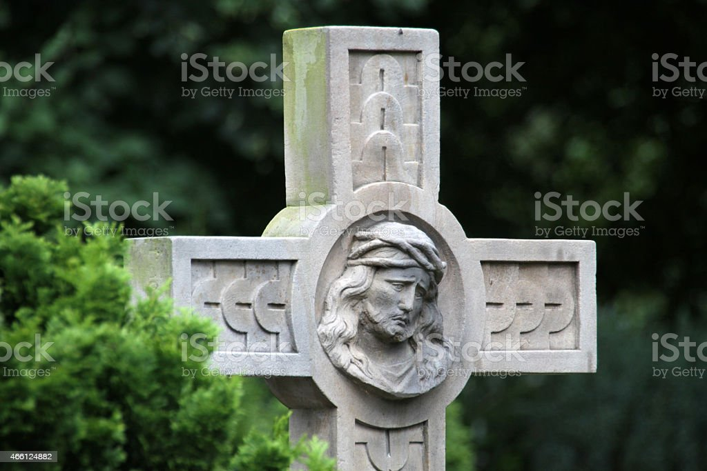 Grave cross in a cemetery stock photo