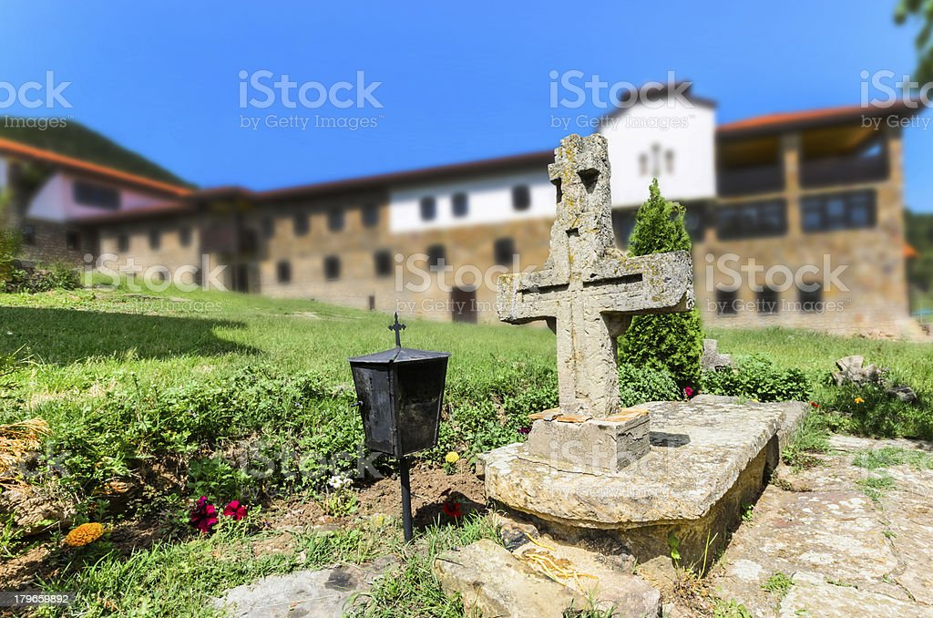 Grave cross in old Church and Monastery complex royalty-free stock photo