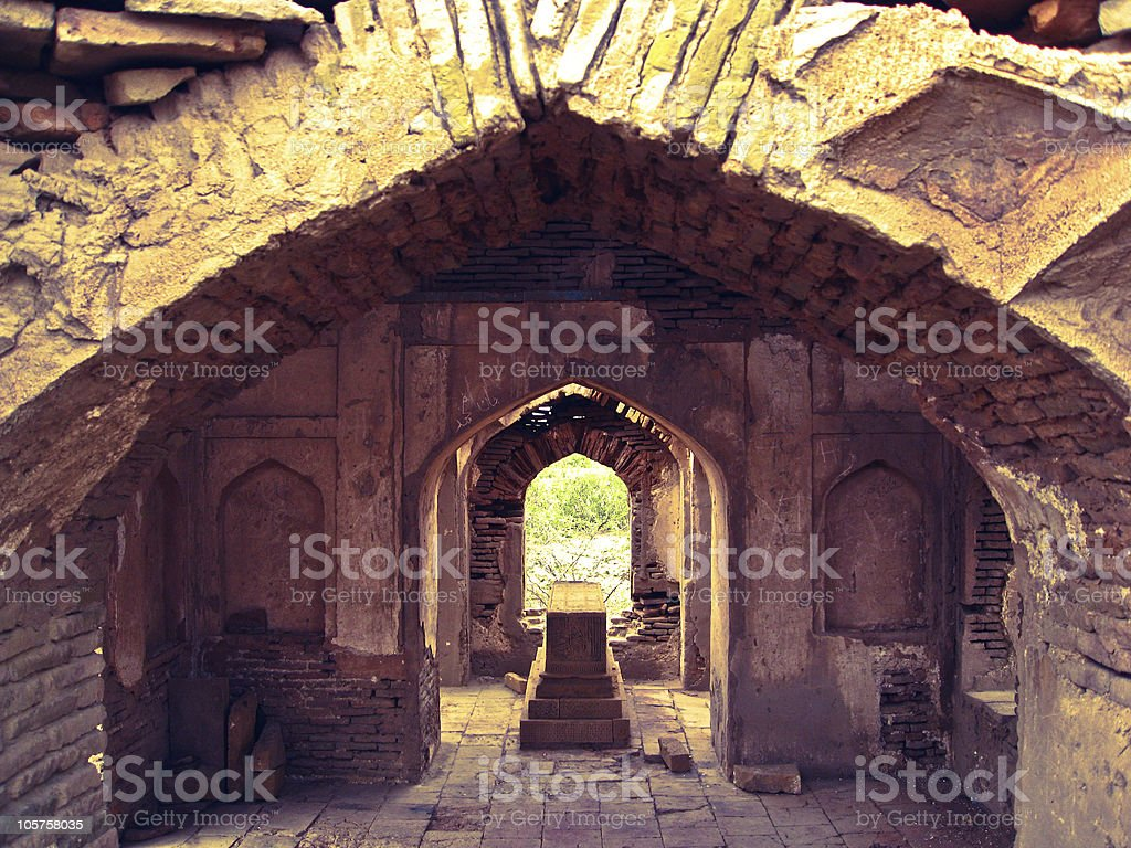 Grave in a deteriorating tomb stock photo
