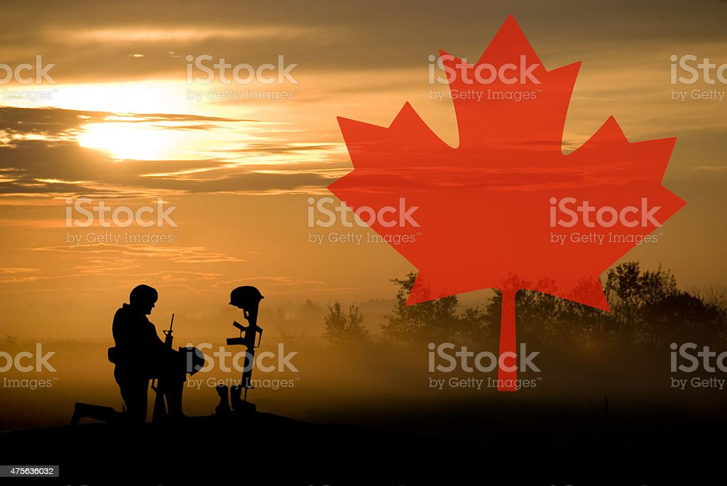 Grave of Fallen Soldier and Canadian Maple Leaf- Remembrance Day stock photo