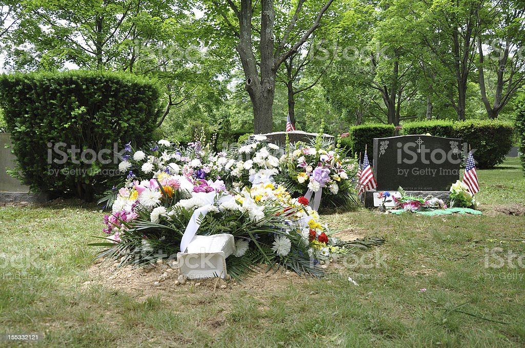 Grave site covered with flowers stock photo