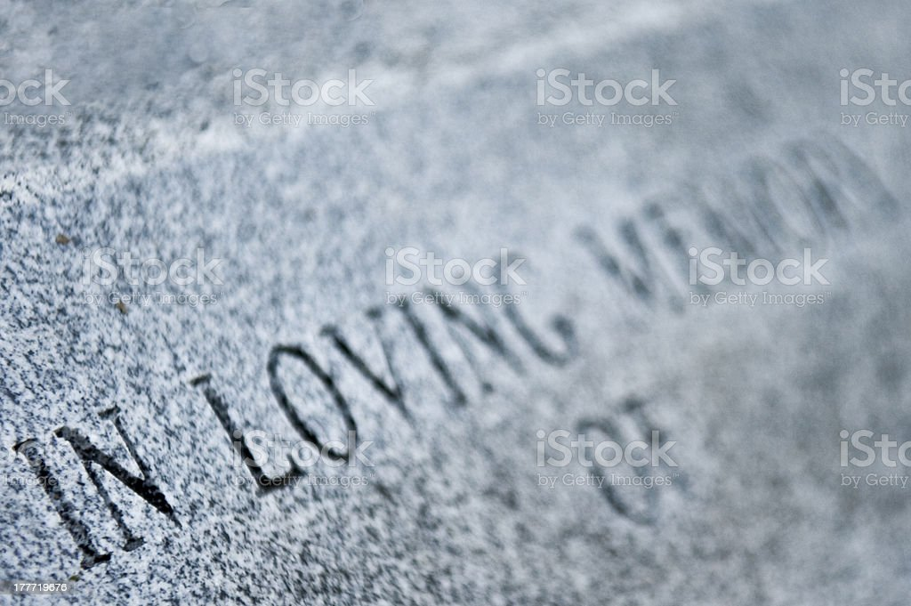 Grave stone with inscription stock photo