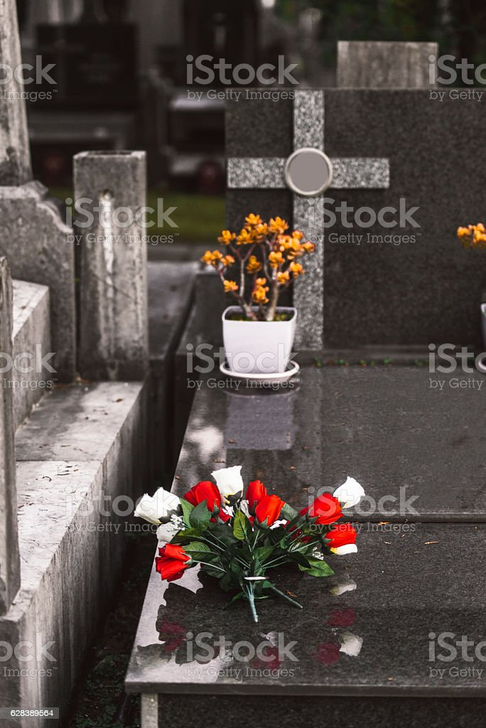 Grave with flowers stock photo