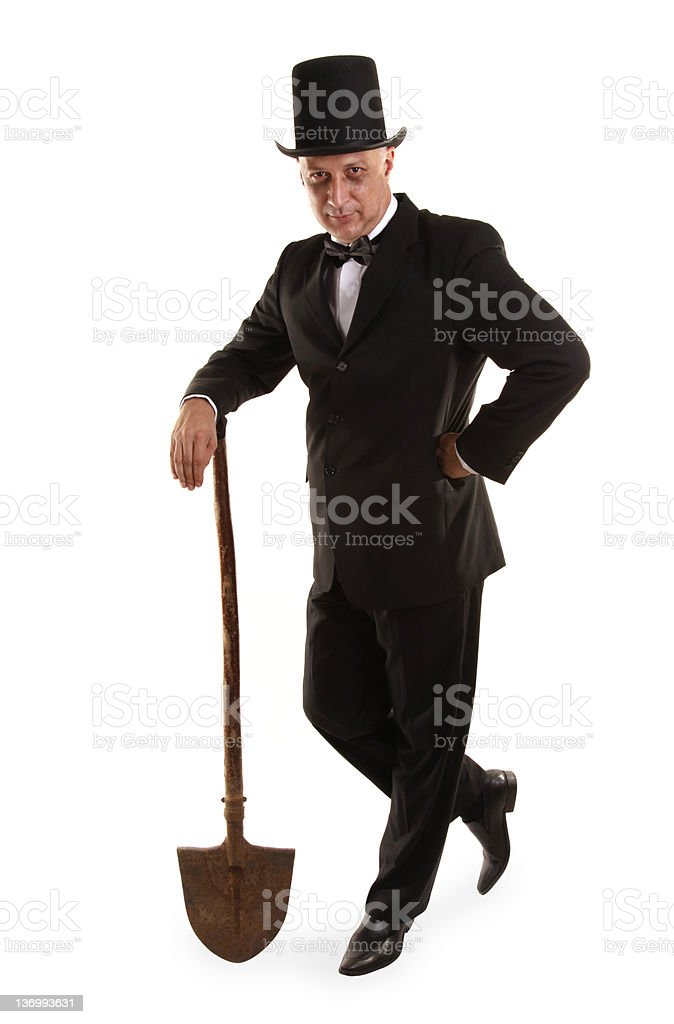 Gravedigger is standing with dirty spade stock photo