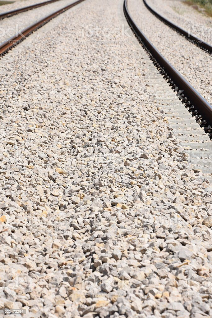 Gravel and  railroad track stock photo