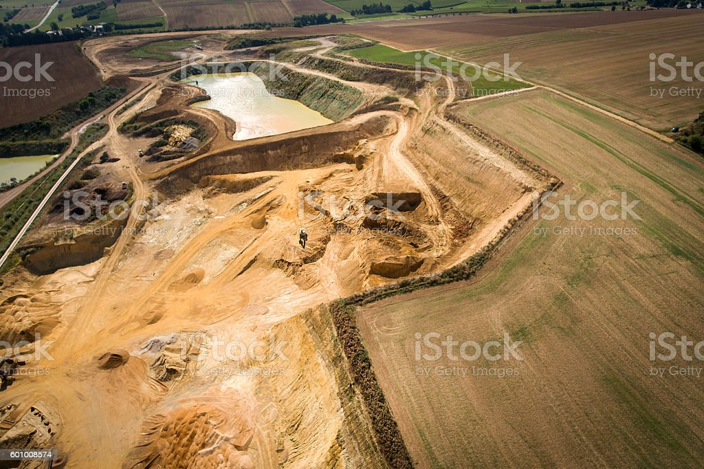 Gravel and sand quarry - aerial view stock photo