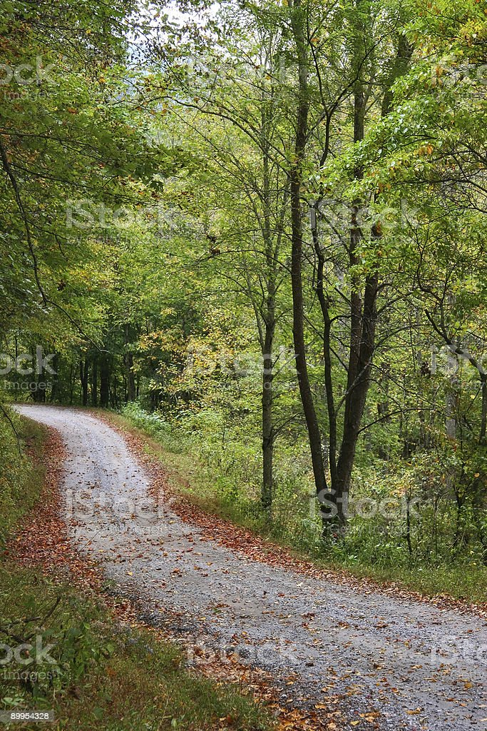 Gravel Dirt Road Going Downhill royalty-free stock photo
