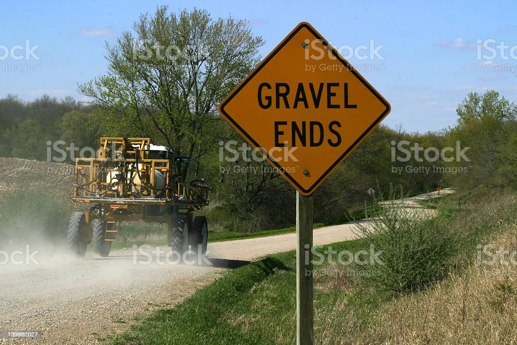 Gravel Ends Sign with Farm Equipment stock photo