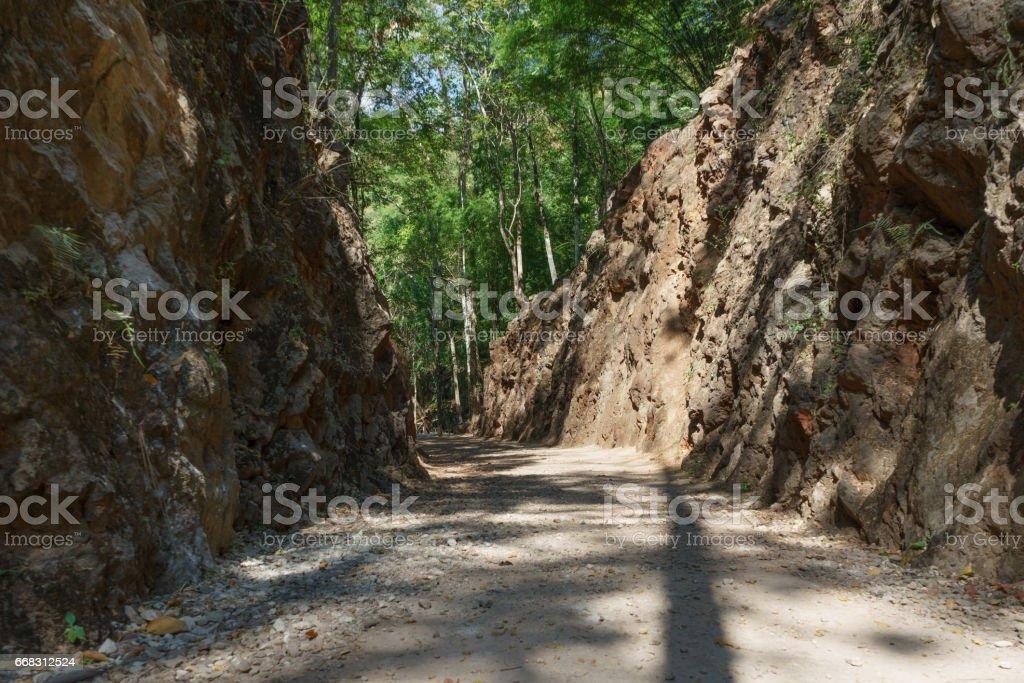 Gravel path through Hellfire Pass in Kanchanaburi, Thailand stock photo