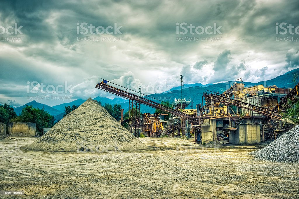 Gravel Piles And Factory Against Cloudscape stock photo