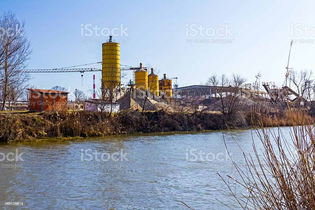 Gravel pit with several silos stock photo