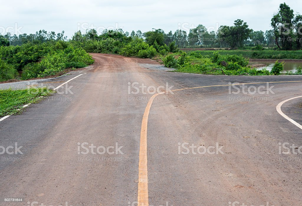 Gravel road and  asphalt road stock photo