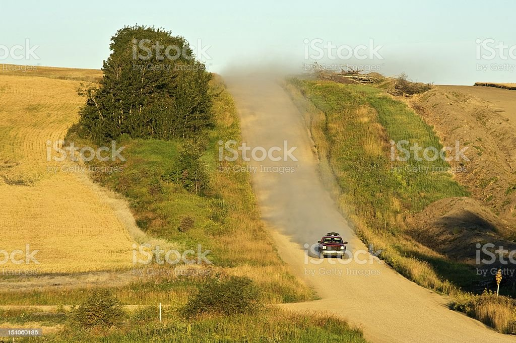 gravel road and pipleine cut stock photo