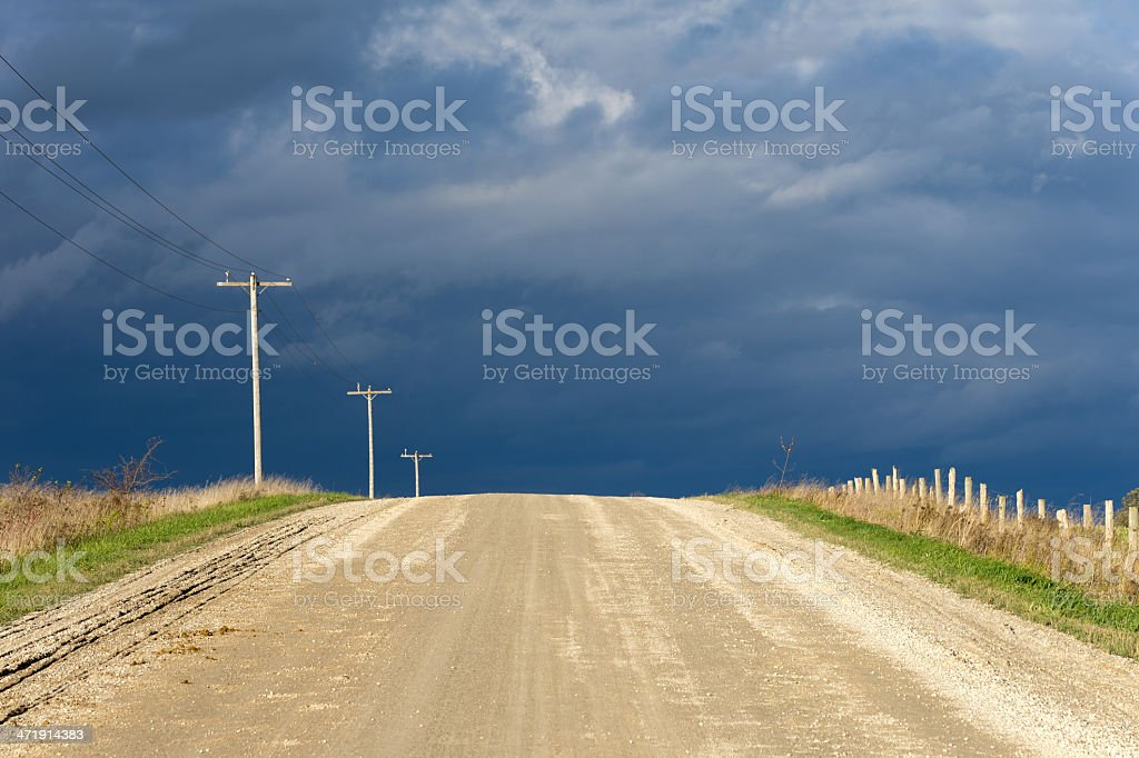 Gravel Road and Storm Clouds royalty-free stock photo