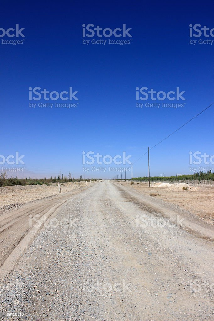 Gravel road and the blue sky stock photo