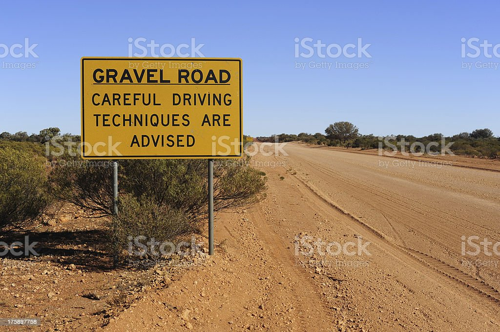 Gravel Road Careful Driving Sign royalty-free stock photo