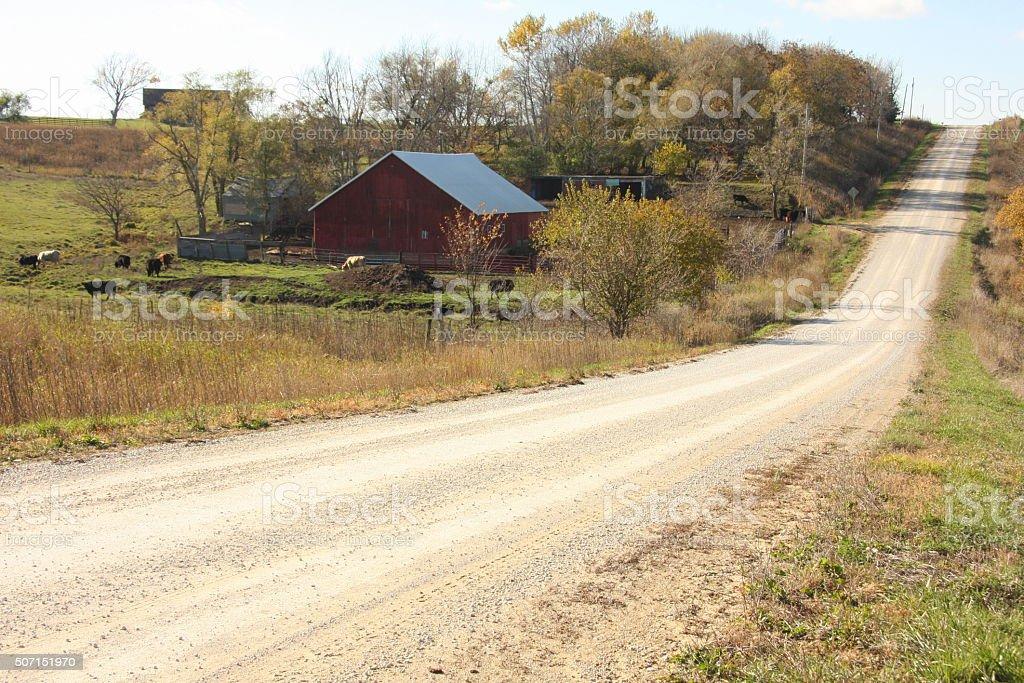 Gravel Road Runs Past Iowa Barn stock photo
