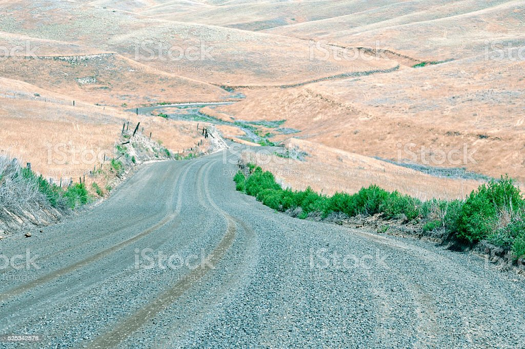 Gravel road through ranchland in eastern Washington state stock photo