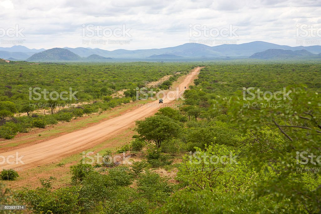 Gravel road with 4x4 car driving and the Zebra mountains stock photo