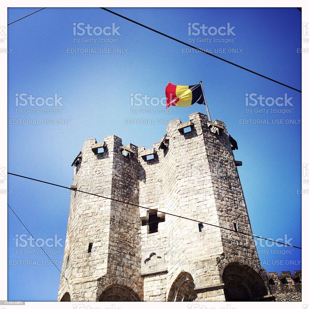 Gravensteen Castle in Ghent with a Belgian flag stock photo