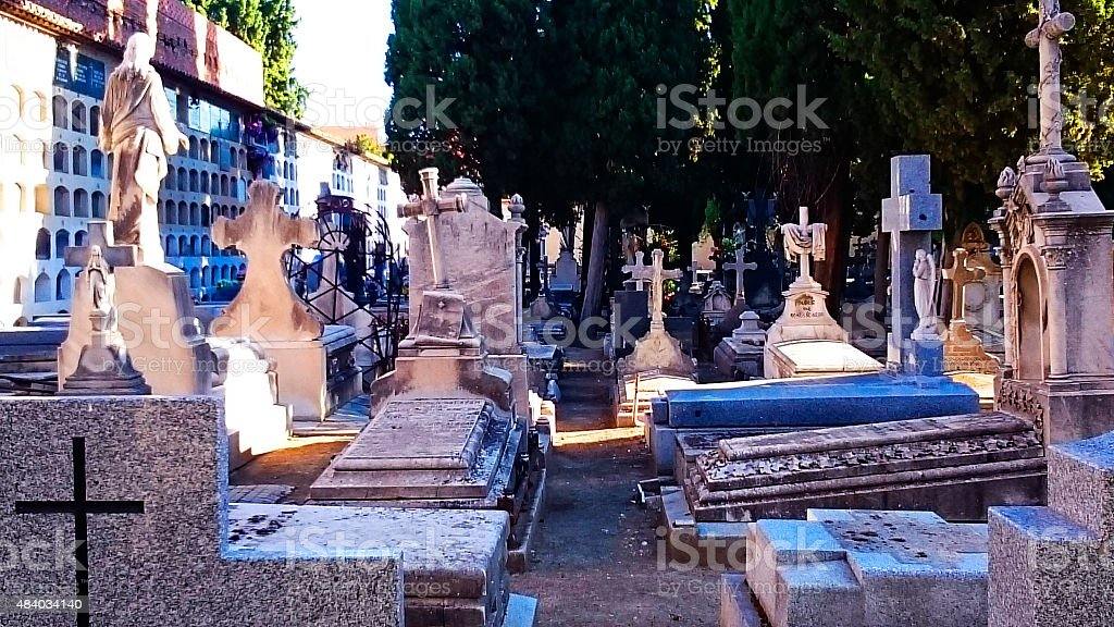 Graves and tombstones in the morning July stock photo