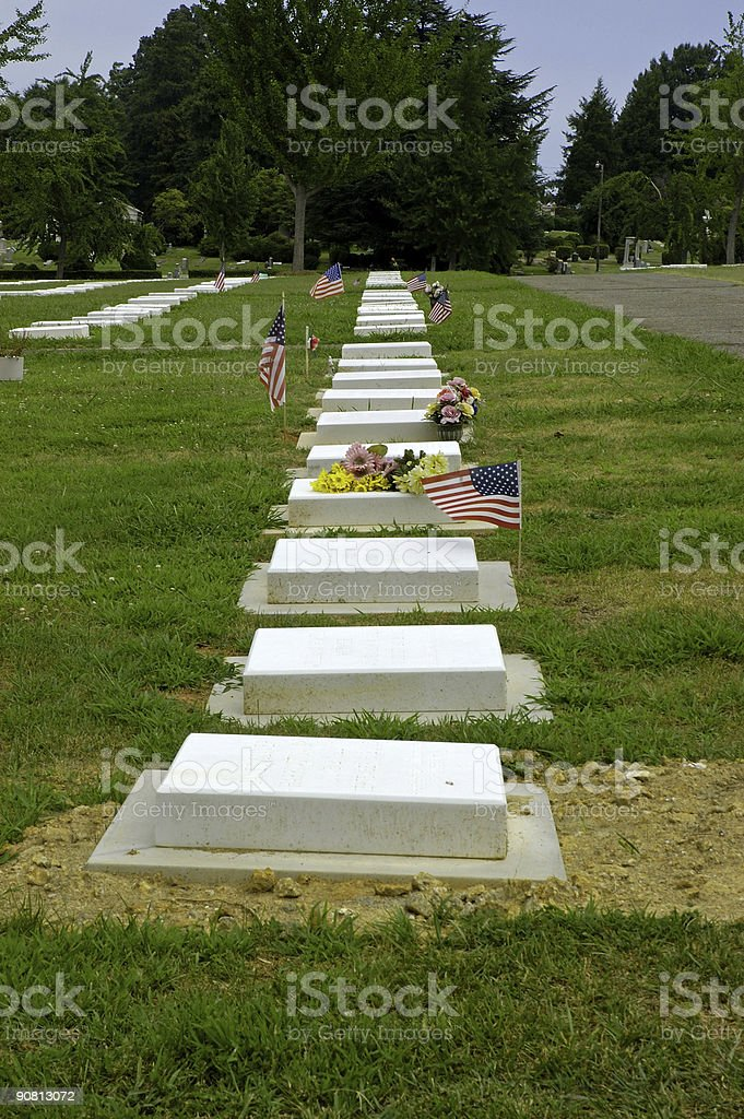 Graves, flowers and flags stock photo